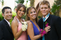 Popular : Well-dressed teenage couples outside portrait