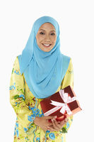 Popular : Woman holding a red gift box