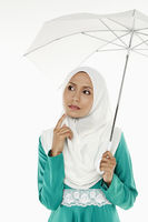 Popular : Woman in traditional clothing holding an umbrella  contemplating