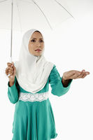 Popular : Woman in traditional clothing holding an umbrella