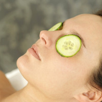 Popular : Woman lying down with sliced cucumbers covering her eyes