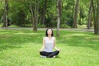 Woman practising yoga in the park