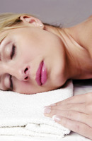 Popular : Woman resting on a towel with her eyes closed