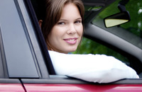 Woman sitting in a car smiling