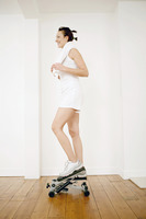 Woman stepping on exercise equipment