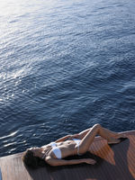 Woman sunbathing on boat