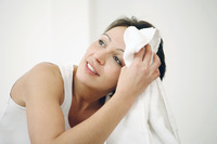 Woman wiping her sweat with towel