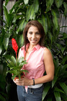 Woman with potted tropical plant  portrait