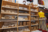 Wooden handicrafts displayed on shelves in gift store