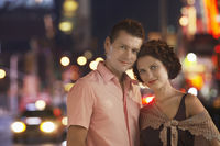 Young couple in the city at night portrait