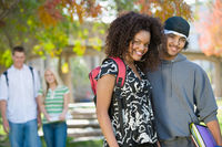 Young student couple on campus  portrait