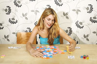 Young woman counting gambling chips of winning hand