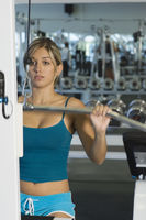 Popular : Young woman working out on weightlifting machine