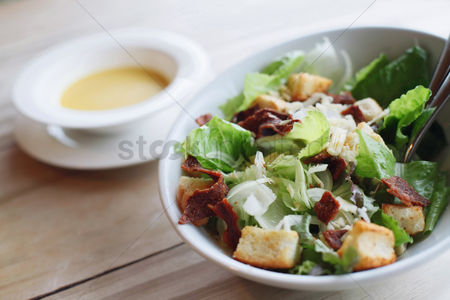 Ready to eat : A bowl of salad with croutons