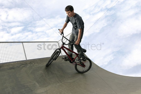 Lively : A boy cycling in a skateboard park