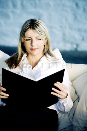 Tidy : A business lady reading on a couch