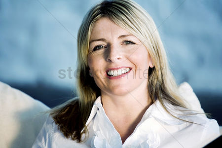 Satisfaction : A business lady smiling at the camera