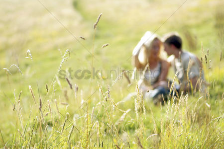 Grass : A couple sitting together on the prairie