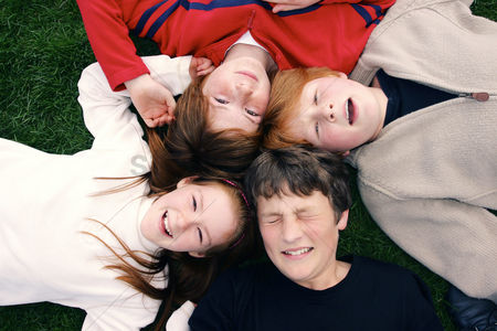 Outdoor : A group of kids lying in circle on the field