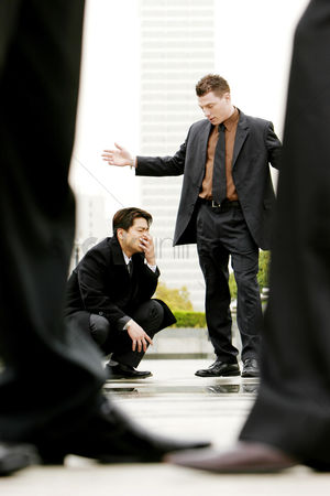 Supervisor : A man being scolded by his superior