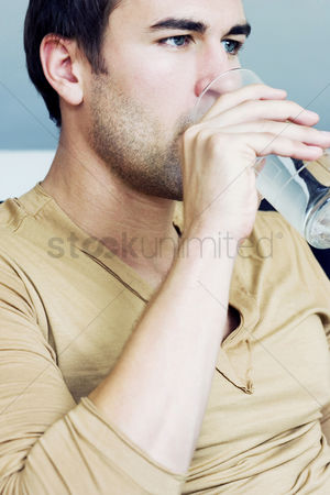 Adulthood : A man drinking water