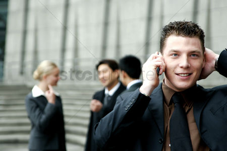 Cell phone : A man in business suit talking on the hand phone