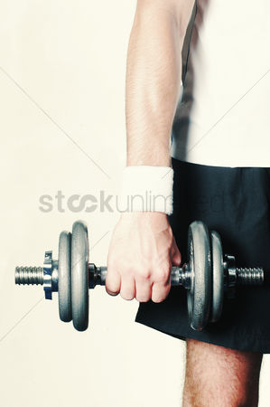 Strong : A muscular right hand holding a dumbbell