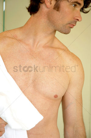 Tidy : A shirtless man taking towel for a bath