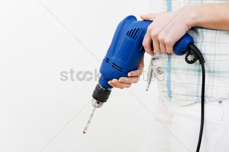 Fix : A woman holding power drill