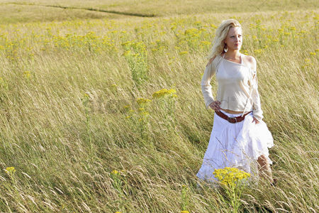Having fun : A woman standing alone on the prairie