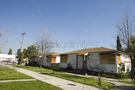 Loss : Abandoned houses with boarded up windows