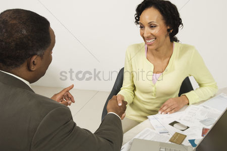 Accessibility : Accountant shaking client s hand