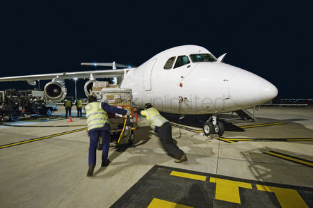 Transportation : Airfreight loading onto bae-146 at night