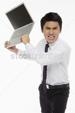 Portability : Angry businessman throwing a laptop