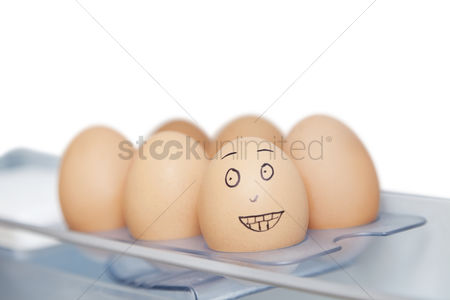 Egg tray : Anthropomorphic and plain brown eggs in carton against white background