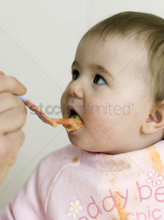 Appetite : Baby being fed with baby food