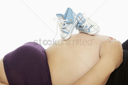 Malaysian : Baby booties placed on a pregnant woman s belly