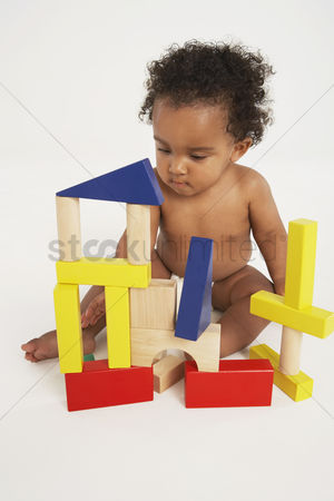 Curly hair : Baby playing with building blocks