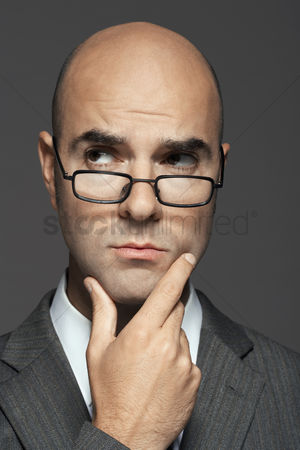 Bald : Bald man wearing glasses with hand on chin