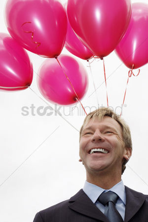Funny : Balloons above businessman s head