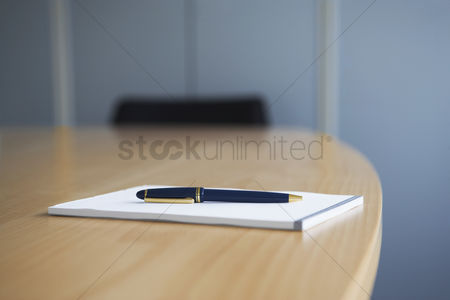 Notepad : Ballpoint pen and notepad on conference table