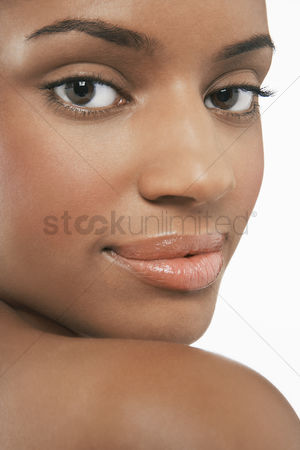 Black background : Beautiful young  looking over shoulder