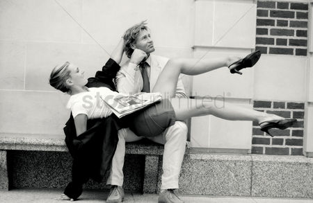 Lover : Black and white picture of a couple in office attire doing a tango dance by the street