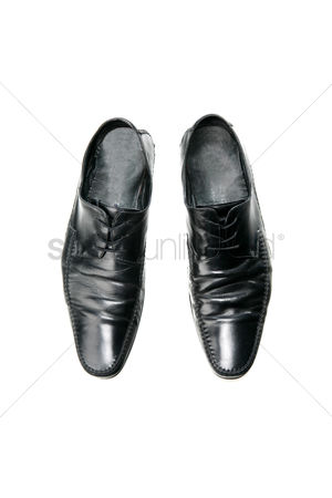 Traditional clothing : Black boot on white background
