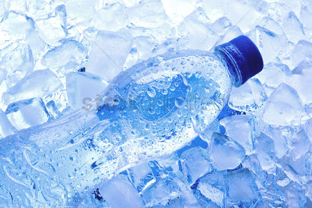 Refreshment : Bottled water with ice cubes