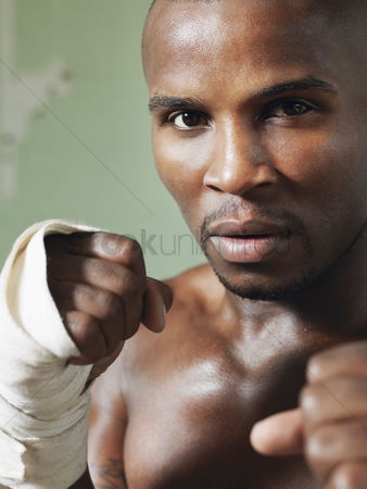 Determined : Boxer with raised fists close-up