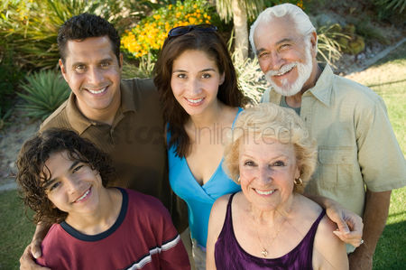 Husband : Boy  13-15  with parents and grandparents outside elevated view portrait