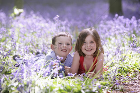 Spring : Boy and girl in field of flowers