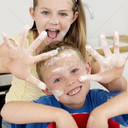 Bowl : Boy and girl with their hands and faces covered with flour