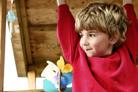 Children playing : Boy in red sweater smiling